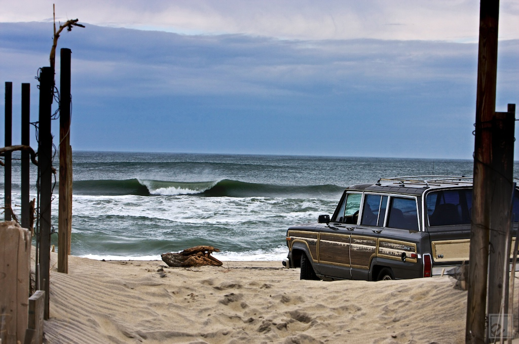 a woody overlooks a peeling A-frame wave in The Outer Banks