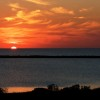 a fire like sky in classic cape hatteras sunset over the pamlico sound