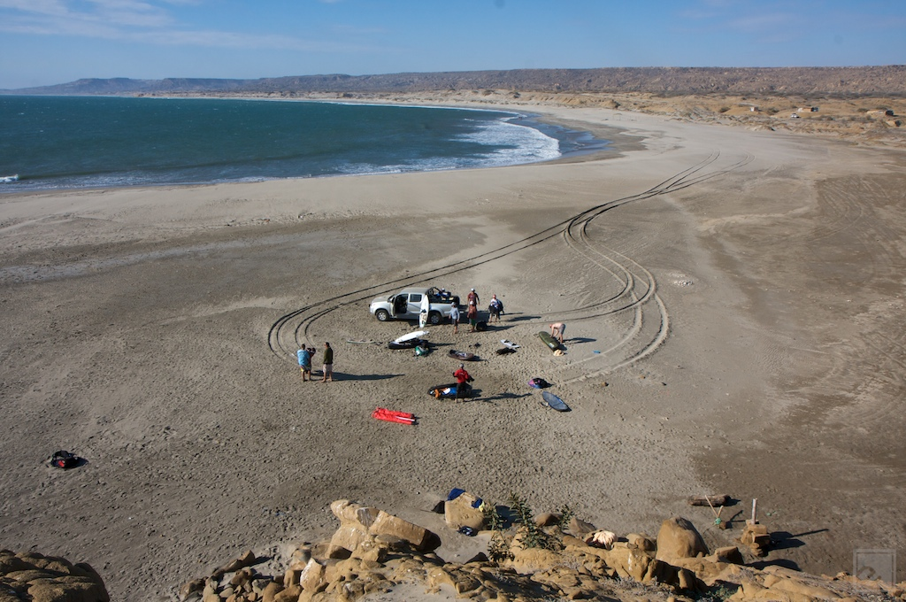 kiteboarders post up for a desolate session in northern peru