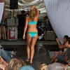 a swimsuit model walks down the runway