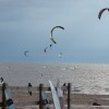 Kiteboarders riding on lake michigan