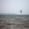 A kiteboarder riding on Muskegon Lake