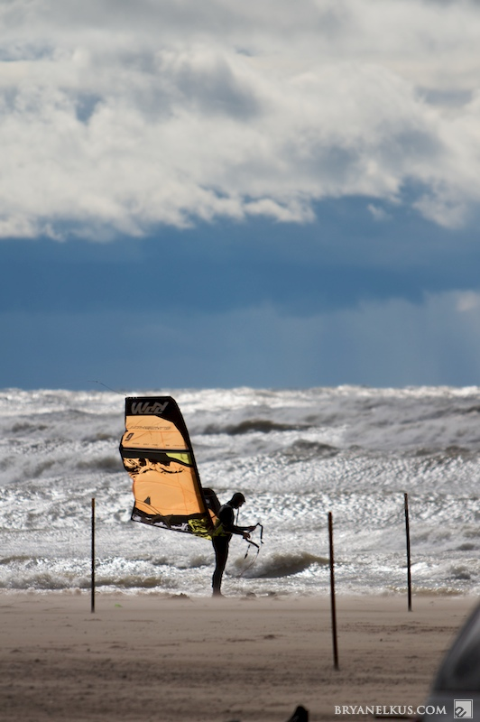 A kiter on the beach of lake michigan preparing to ride