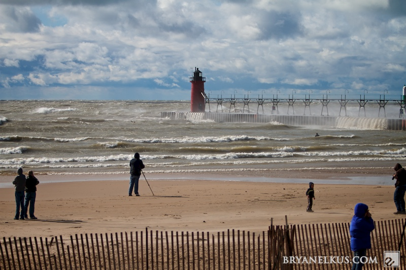 onlookers whatch as watermen headout into the rough waters off south haven mi