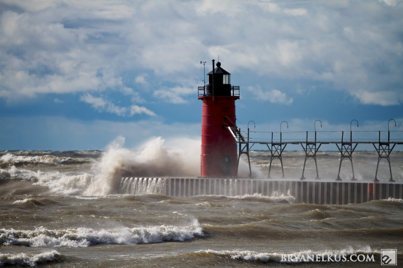 the south haven pier getting battered by waves on lake michigan
