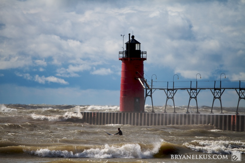 a surfer infront of the south haven pier