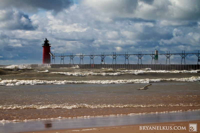 a stormy scene of the south haven mi lighthouse