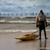 a kayaker looks out at the rough waters before heading back out for a paddle