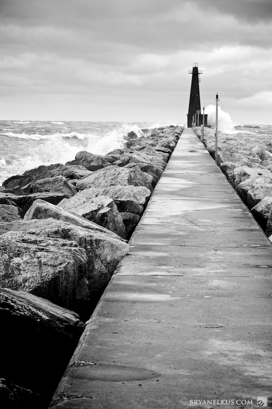 Pier to the Muskegon Lighthouse on a stormy day