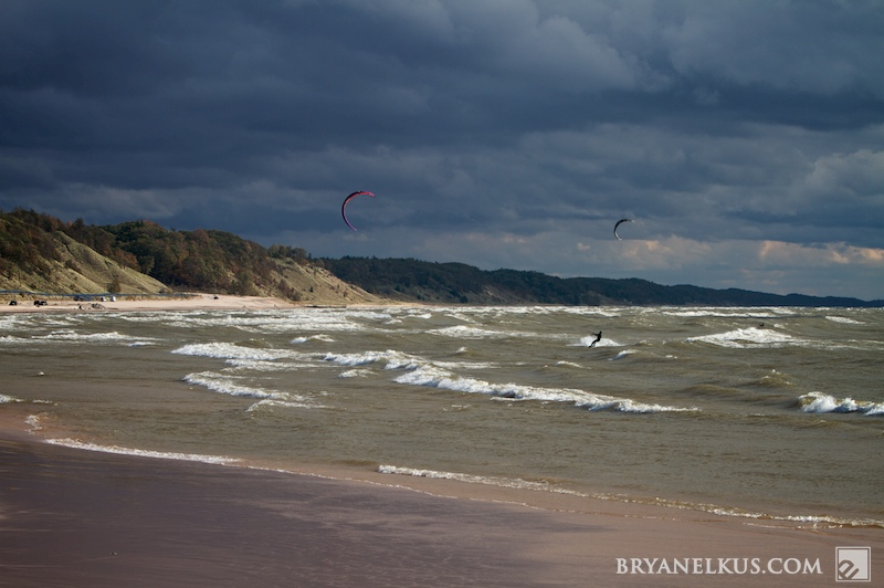 Kitesurfers out on lake michigan in stormy conditions