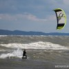 a kiteboarder riding on lake michigan