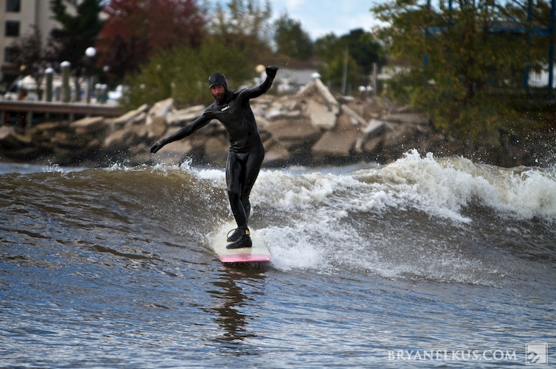 a surfer cross stepping in lake michigan
