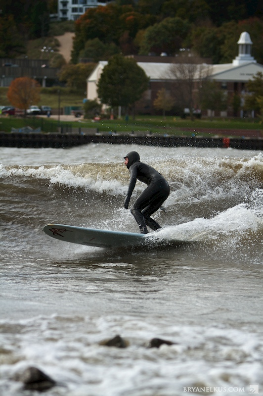 a surfer riding in lake michigan