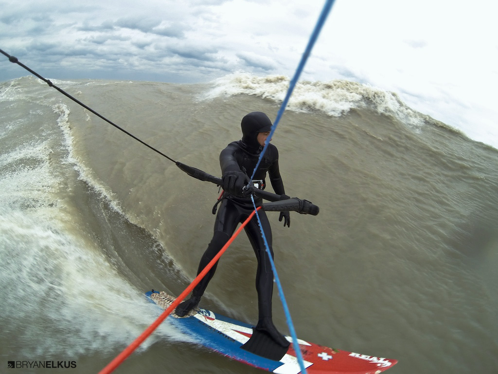 A kiteboarder rides a wave on lake erie near Erieau canada